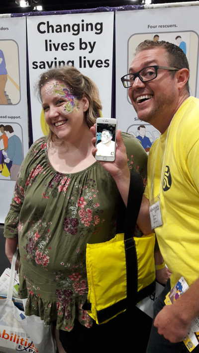 A visitor to the ADAPTS booth showing off her face painting
