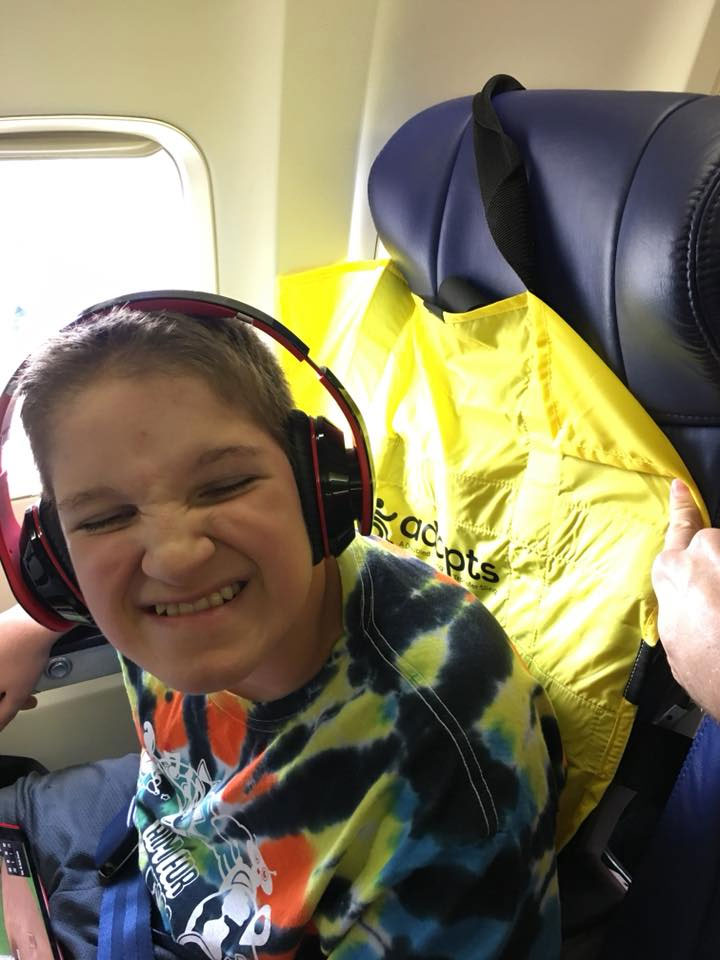 Kaleb on a plane with his ADAPTS