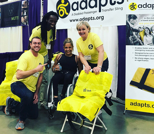 The ADAPTS team poses with a booth visitor