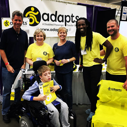 A boy and his family visiting the ADAPTS booth